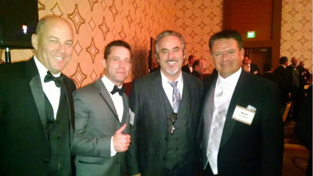 Eric Lowey, Terry Bricker (Merchants Bonding Company) David Feherty Broadcaster with CBS Sports and the Golf Channel.